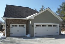 Monterey Taupe Hardie Board & Batten and Hardie Lap Siding  Chesterfield, MO (63005) / This is a new construction house that features Hardie Board & Batten (Monterey Taupe) and Hardie Lap Siding (Monterey Taupe). It is located in the city of Chesterfield, Missouri.