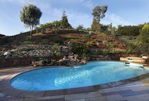 Landscaping a steep block with swimming pool / Ideas for a site with a pool at the bottom of a steep slope and the house going down the slope