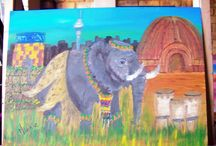 South African Big 5 / These 5 A3 sized paintings were done in oils on canvas board.  It is a reflection of South Africa.  Each animal is depicted in traditional wear and set against important South African landmarks.