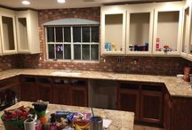 Kitchen Brick Tile Back Splashes / A brick tile kitchen back splash simulates the look of an old, exposed wall. Seal it with a penetrating sealer, and splashes will not stain your wall.