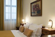 Hotel rooms / We offer luxurious rooms, which combine historical décor with modern comfort. Some of them are with a stunning view of the historical centre of Prague.