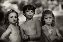 Sally Mann / Sally Mann (May 1, 1951) is an American photographer, best known for her large black-and-white photographs—at first of her young children, then later of landscapes suggesting decay and death.