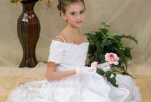 Satin and Beaded First Communion Gown Style 6512 / Off the shoulder full length first communion dress with longer length in back to give a 'train look'. Gorgeous cutout design throughout.  Top has detailed appliques with pearl accents. Fully lined. Zipper closure All White, Full length. Available exclusively at Christian Expressions  http://www.firstcommunions.com/first-communion-dresses/first-communion-dresses-6512.html