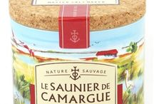 Camargue / Fleur De Sel de Camargue is hand raked and harvested in France, where only the premium top layer of the salt bed is used. The name Fleur De Sel comes from the aroma of violets that develops as the salt dries. Each signature container is sealed with a cork top and signed by the Salt Raker who harvested it.