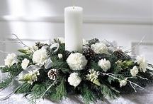 composition florale avec bougies pour Noël