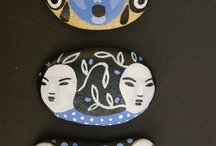 painted pebbles and faces