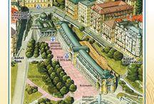 """Panoramatický plán a obrazový průvodce - Bildstadtplan - City Map & Guide / Panoramatický plán a obrazový průvodce byl nakladatelstvím M'Plan s.r.o. Mariánské Lázně uveden na trh již v roce 1992 vydáním titulu """"Mariánské Lázně"""". Byla to první publikace tohoto druhu v ČR, která předurčila směr a úspěch celé edice."""