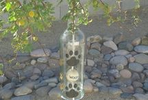 Eco friendly clear bottle chimes / Hand painted with multi colored and size dog paws chimes.