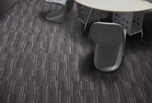 Neutron / NEUTRON is a modern heavy contract multi-level textured loop carpet tile,  This product is ideal for office and commercial areas.  Paragon offer a 10 year wear warranty and this product passes the flammability test and are suitable to be used with caster chairs.  With 6 colour ways to choose from, this product can be laid easily as checkerboard, Monolithic, Vertical and Horizontal step or brick.