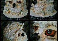 My Owl cake / Owl Birthday Cake. This cake was terribly Fun!!!! I had three things to go on. The 15 year old young lady liked owls, the colour blue and Justin Beiber. I deciede an owl would be the way to go lol! Chocolate fudge gateau with layers of chocolate truffle and Italian Meringue Buttercream. All edible!  Eyes and beak painted with white spirit and food colouring. Lots of icing feathers lol! www.facebook.com/LMCake