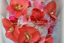 Coral Bridal Flowers / We create a stunning range of bridal bouquets and wedding flowers in a wide range of artificial flowers in all colours, here you will find our coral themed brides bouquets, posies, buttonholes and corsages