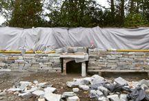 Bau einer Trockenmauer aus Naturstein für den Garten
