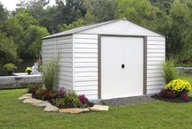 Vinyl Milford Steel Storage Shed / The Vinyl Milford Steel Storage Shed Series is made from Electror galvanized Steel with a long lasting vinyl coating that offers superior corrosion protection.  The Vinyl Milford is offered in 2 sizes the 10' x 8' and 10' x 12' garden sheds.   The sheds have appealing aesthetics with horizontal steel siding in the Almond and Grey Bark color.