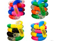 Tangle toys / Tangle toys are a fidget toy made of 18 curved pieces of plastic, which makes it perfect for moving around and stimming with. They are totally silent, so are perfect for a work or classroom environment!