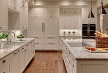 TRANSITIONAL KITCHENS / Think of a transitional kitchen as the great moderator. With the warmth and welcome of traditional design and the clean, simple lines of contemporary style, transitional spaces project balance and harmony. Because they offer a great deal of flexibility, they're a great choice for homeowners whose taste spans the two.  Sheila Schmitz