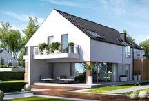 HomeKONCEPT 19 | Projekt domu / HomeKONCEPT-19 to propozycja jednego z najnowocześniejszych domów w naszej kolekcji. Prosta, minimalistyczna bryła, bezokapowy dach oraz ciekawe materiały elewacyjne zwracają uwagę z zewnątrz. Jest to projekt domu energooszczędnego. Zastosowaliśmy tu wentylację mechaniczną z odzyskiem ciepła, odpowiednio grube ocieplenie przegród oraz energooszczędną stolarkę okienną i drzwiową.