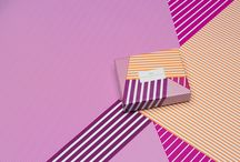 Graphic CHIC / A supercharged, hypnotic energy has taken over the macaron gift boxes turning the tables on chic and pleasure.  Stunning graphics, trendy, almost sparkling offer visions of gourmandise.  Vibrant stripes create optical illusions; the pop art lines bring an impressionistic lightness.  Free-form vibrant patterns underscore in bold colours our cravings for this delicate round cookie.  #lamaisonduchocolat #graphicchic #chocolate #macaron #yummy #summer #newcollection