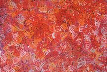 Emily Pwerle / Emily Pwerle (pronounced Pooh-la, also spelled Apwerl, Pwerl, Pula), is the sister of another very well known artist, Minnie Pwerle, and comes from the area of Utopia, also known as Urauntja, which lies 300 km northeast of Alice Springs,