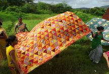 Patchwork Quilts / Handmade quilts made all over the world. Patchwork and Yo Yo quilts made in India by village women. Empowering women and giving opportunity to those in need.