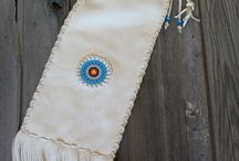 Thunder Rose Beadwork / I have a variety of beadwork that I offer on our leather bags. I do rosettes, applique , different totems , and linear beadwork.