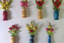 Miniature paper flowers in vase