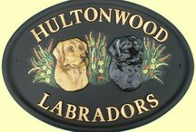 Dogs on house signs / Dog designs on house signs & door plaques, raised motifs & flat painted special commissions.