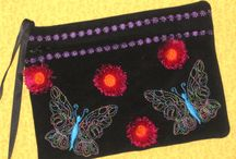 In the Hoop Embroidery Designs! Purses, toys, mug rugs & more! / In the hoop embroidery designs and projects. Purses, mug rugs, toys, kitchen accessories, wristlets, dolls, clutches, taggy toys, holiday gift and crafter embroidery designs. Great projects for the craft show embroidery seller.