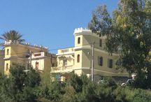 Μικρολίμανο -  Mikrolimano Piraeus / Εκλεκτικιστική μονοκατοικία με δίδυμή της στο Μικρολίμανο, όπου έζησε ο ζωγράφος Ροϊλός, και πρόσφατα αναστηλώθηκε από την Αρχιτεκτονική Εταιρεία του Νικόλα Ντόριζα για να στεγάσει γραφεία ναυτιλιακής.  Eclectic twin building in Mikrolimano Piraeus Greece, home of late painter Roilos, recently restructured by the Architectural Company of Nikolas Dorizas, to become the headquarters of a Naval Company.