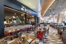 Zizzi Glasgow Silverburn / We've arrived in Silverburn Shopping Centre! For our newest restaurant, the interior takes inspiration from the local area and features artwork by Ricardo  Bessa, whose illustrations depict the stunning Pollok Country Park. Stop by after a fun-filled day of shopping activities for a refuel in a relaxed and stylish setting.