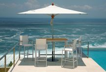 Aluminium Collection / Lovely for use indoors, outdoors or even poolside, perfect for dining and leisure. These Aura high dining carver chairs have a foot bar to keep them sturdy and a protective cover that will resist marking. The arms of these sophisticated chairs are made from teak.  See more at: http://www.teak.com/english/aluminium-high-dining-1AUHC.shtml