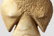 Sculpture archeology / wood, metal stone