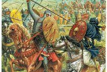 Historia Medieval: Militar / Documenta los avances en las artes de la guerra de los diferentes ejércitos en contienda, poniendo en relación los movimientos de los ejércitos, los frentes y grandes batallas, con sus capacidades técnicas y estratégicas.