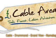 Explore Cable WI / www.woodlanddevrealty.com
