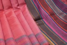 Champa Chronicles /  Beautiful Saris made with Tussar, Twills and Dupion blends with self stripes, tied and dyed yarns and multi colored pallas with woolen yarns.