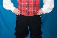 Gudbrandsdalen lang jakke / Gudbrandsdalen har oppgjennom tidene hatt flere ulike herrebunader i bruk, men i 1962 ble det satt i gang produksjon av en bunad med tre ulike jakker; kort eller halvlang sort jakke, eller halvlang hvit jakke. De halvlange jakkene er kantet med rødt og har oppstående krage. Den korte jakken har ståkrage og nedbrettede slag. Alle jakkene er dobbelspent, men kan ikke kneppes. Vesten er mest vanlig i rutastoff, men også brokade og damask brukes. Det finnes både nikkers og lang bukse til bunaden, be