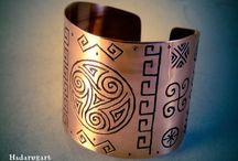 Simboluri dacice gravate in cupru