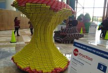 Canstruction / Canstruction® is a unique charity which hosts competitions, exhibitions and events showcasing colossal structures made entirely out of full cans of food. After the structures are built, the cansculptures® go on display to the public as a giant art exhibition. At the end of the event, all food is donated to local hunger relief organizations.