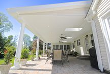 Custom Outdoor Porch and Patio Overhead in Huntington, NY / We completed this project in the town of Huntington, NY. We built this entire project from the ground up. An existing deck was removed and a beautiful new overhead and stone patio was built in its place. Three skylights were also included in this project to give this patio natural sunlight.