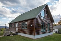 Model 2 / This charming Cape Chalet features a large living space, two main bedrooms and a raised loft area perfect for a den, bedroom or second living room. Our Cape Chalet also features an open floor plan living room, dining room and kitchen with a snack bar.
