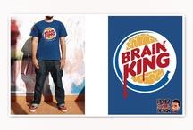 Camisetas Zombies / Diseños para camisetas donde se mezclan dos temáticas, el mundo zombie y las marcas de comida rápida. De esta unión resultaron los modelos Mcerebros y Mc RIP, Brain King, Zomway, Cerebro's Pizza, KFZ y Cerebros Cola.