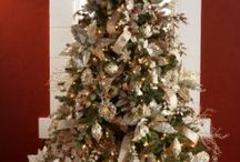 Champagne Frost Collection / Golden ornaments and glittering patterns of snowflakes in the Champagne Frost Collection will enhance the holiday mood in your home or business.  Pair the ornaments with optional designer ribbon and picks for a coordinated holiday look.