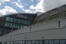 Ageas Bowl, Southamptom / Maple designed and created a curved façade comprising western red cedar blades set within a slimline support system to provide effective shading to the 5 star Hilton hotel and Ageas Bowl in Southampton.