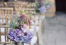 Wedding chair dressing / Flowers on chairs  / by Emma Fawcett-Eustace Flowers