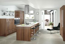 Koa / This dark walnut gloss produces a simple yet stunning modern statement. Fashionable high gloss doors with Brushed Nickel Chunky 'D' handles gives this design a great contemporary feel.