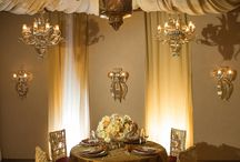 Oksana Flanagan's Russian Wedding Design / A gorgeous Russian Wedding Design created in our showroom for Oksana Flanagan's European Speaking Tour. The team designed a rich and opulent tabletop with touches of gold and red rose accents. Murano Glass Scones were hung on Ivory wall panels, matching chandeliers and pendants were hung overhead. The ceiling and walls were draped with a soft ivory fabric.  / by Revelry Event Designers