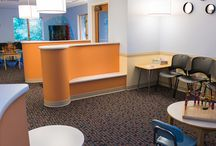 Pioneer Valley Pediatrics / We worked with a design partner to produce this stunning pediatrics environment, performing much of the work off-hours so that the practice could continue to function. Bold colors and curves were used to create warmth and trust. Solidus completely renovated the space, installing a large fish tank and the signature clapboard reception.