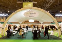 Timber Expo 2015 (part of UK Construction Week) / It was great meeting you at this years UK Construction Week! In addition to our stand we have covered 200 m2 of the Timber Expo halls with EcoCurves VIP Lounge prepared with Base Structures , Relax Zone and entrance feature - all filled with our unique glulam products. We decided to be Timber Expo sponsors again as we believe it is the best place to show our capability to manufacture innovative and great looking glued-laminated structures. Hope to see you next year!