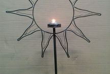candelabro sole / porta candela in ferro realizzato a mano. dimensioni h cm.48 x L 33 ideale per ogni tipo di ambiente. vendibile su facebook ferro matto €/ oggettistica