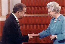 Jonathan Danos receiving an MBE from HM the Queen