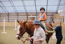 What We Do / Rainbow Therapeutic Riding Center provides equine assisted therapy to our students. This approach uses the horse to achieve a variety of therapeutic goals. These goals can be physical, intellectual, social, educational, emotional, or behavioral.